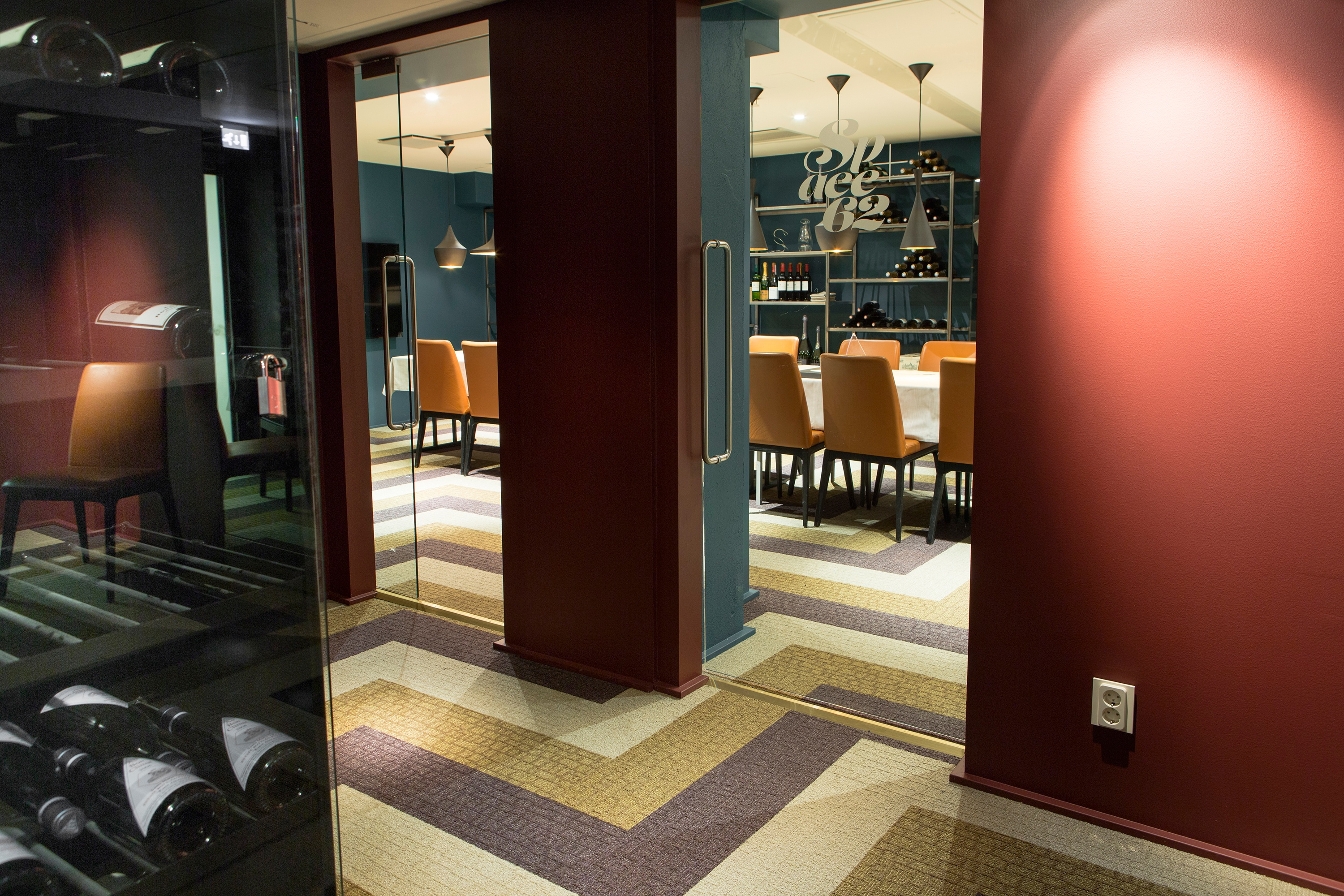 Carpet tiles by ege in red, yellow and white used in a restaurant
