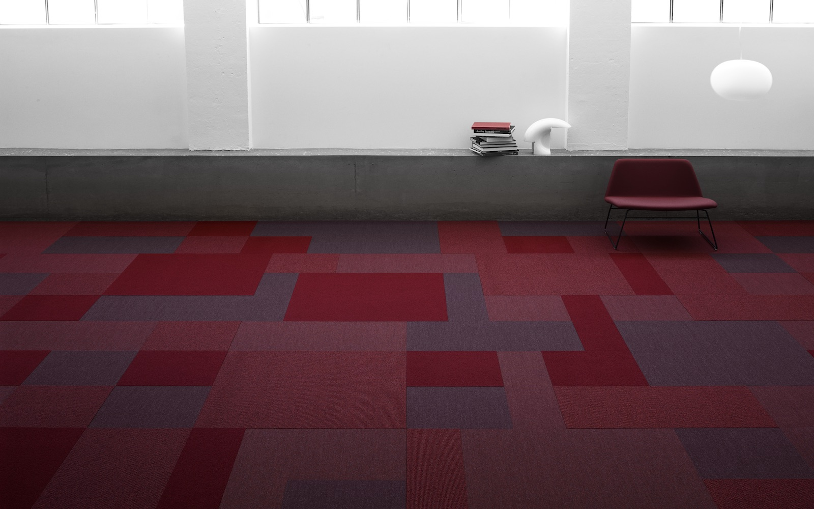 Carpet-tiles-for-hospitality-in-shades-of-red-and-grey