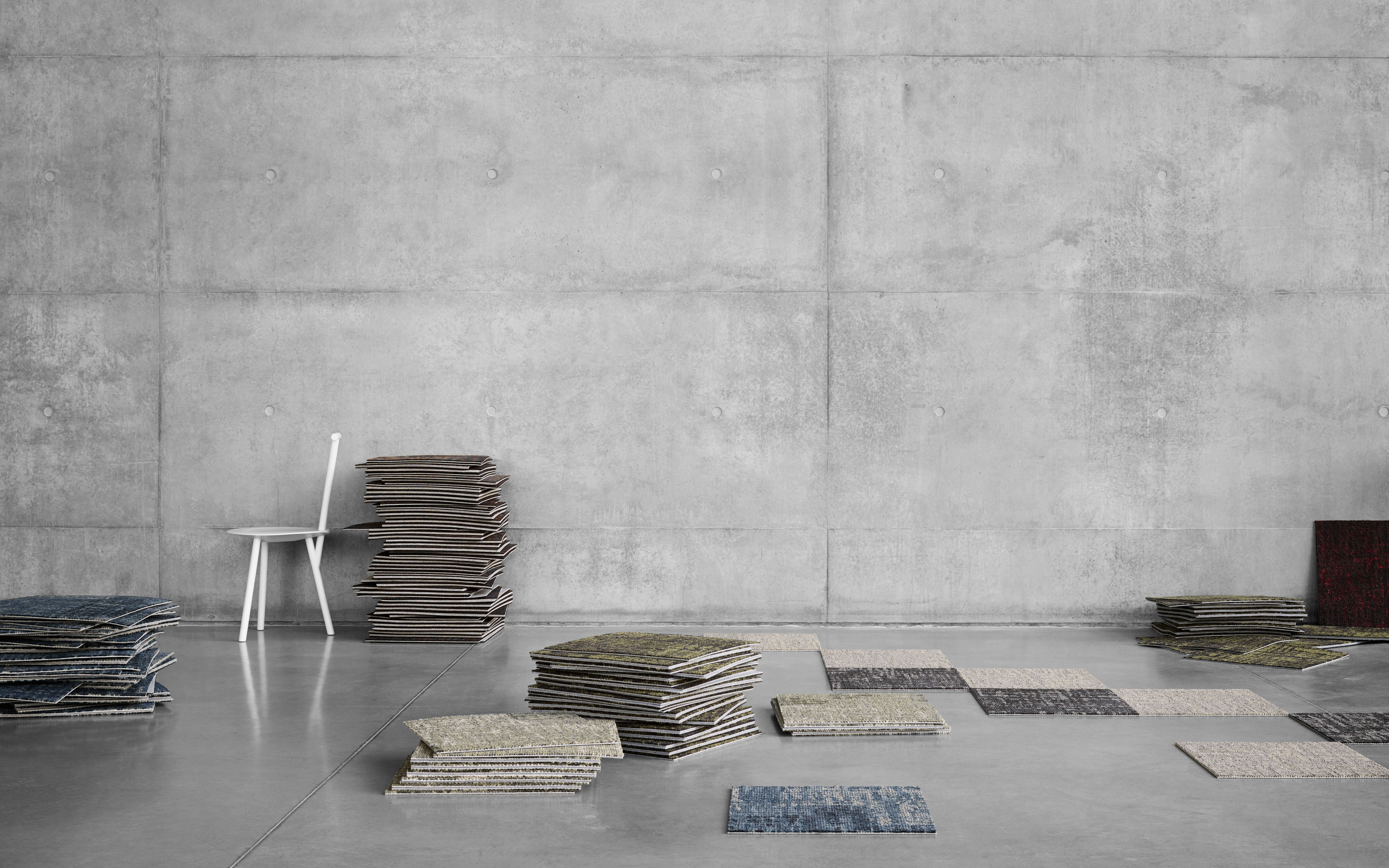 different coloured carpet tile samples in stacks showcase the variety of qualities you can choose from