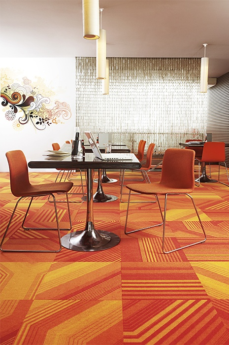 Colourful orange and yellow, striped carpet tiles
