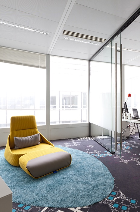 Mixing and matching of intricate carpet design and plush rugs in office design with ege