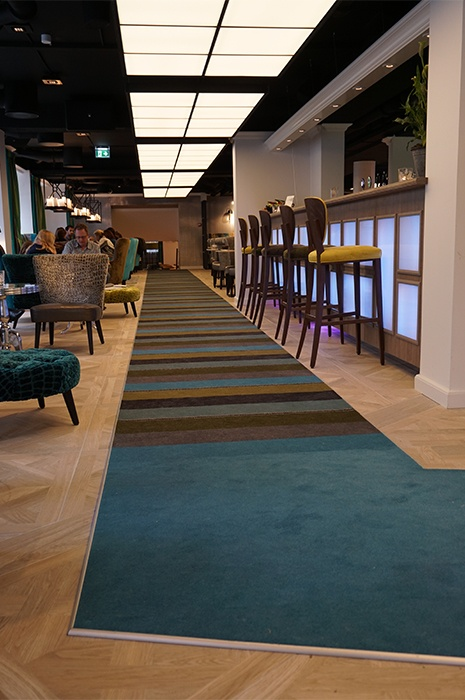 multi-coloured-carpet-creating-pathway-through-restaurant
