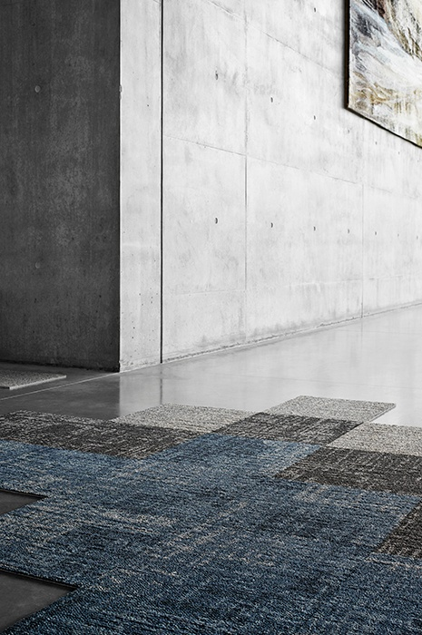blue, grey and black square carpet tiles over concrete floors for an industrial look