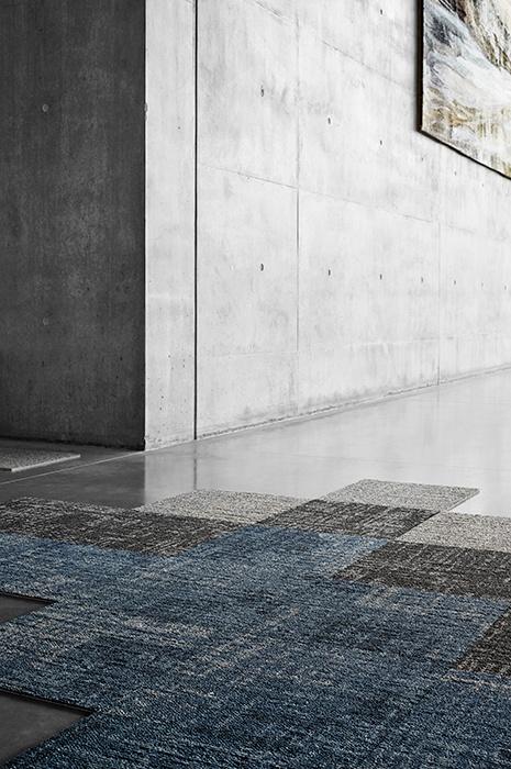 Unfinished carpet tile flooring on concrete