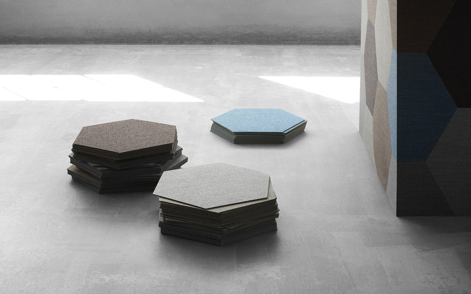 piles of hexagon shaped carpet tiles in brown, white and blue