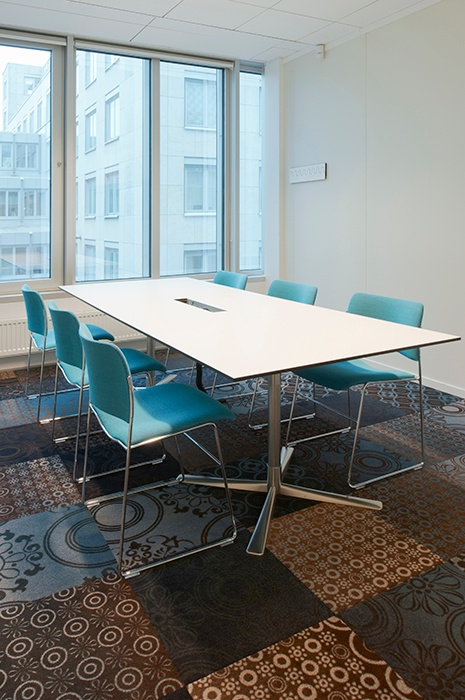 Multi patterned carpet tiles in meeting room