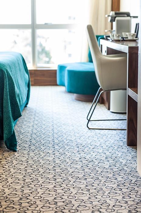 Patterned wall to wall ege carpet at the Epic Sana Lisboa Hotel
