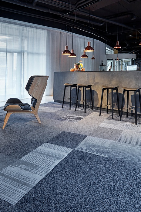 Classy bar, with simple furniture and rugged carpet tiles for flooring