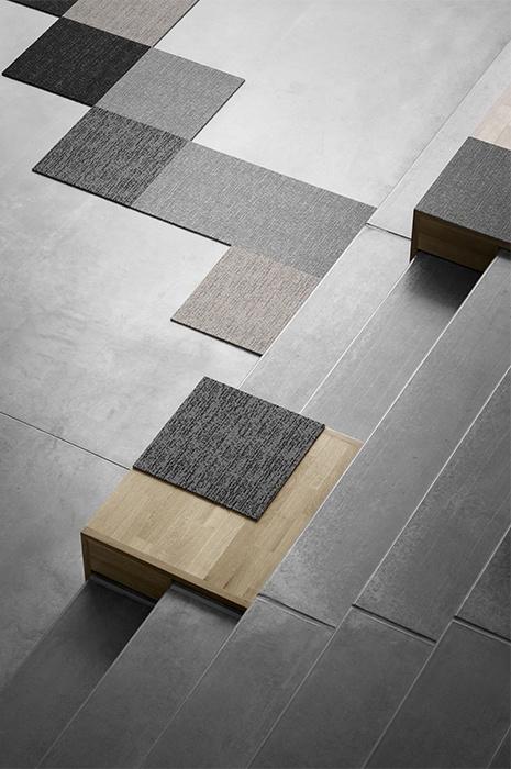 Carpet-tiles-design-laid-out-on-a-plain-concrete-floor