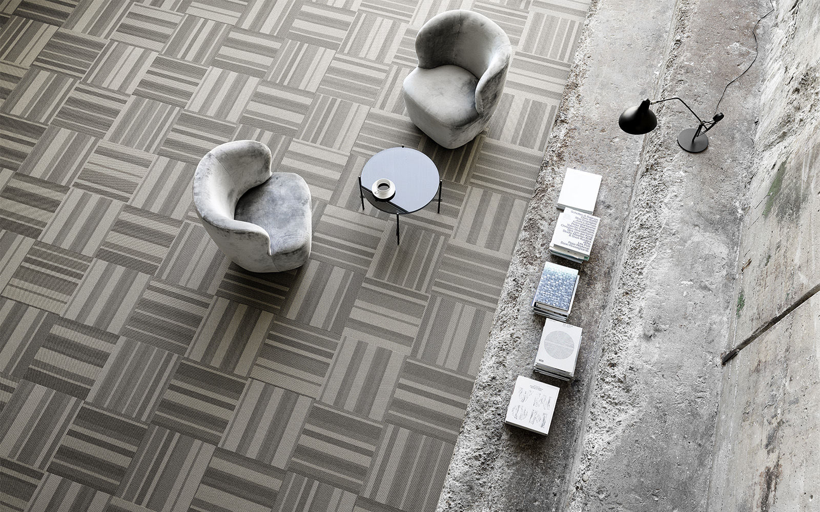 Grey and beige carpet tiles laid in different directions for textural and optical effect