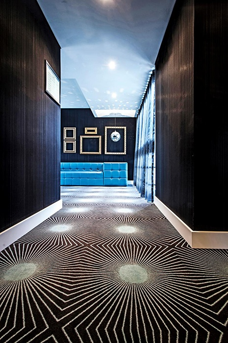 Geometric wall-to-wall carpet by ege, showcasing how carpet design can be used to create optical iIllusions