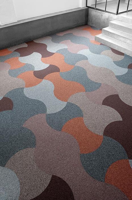 multi-coloured ege carpet tiles create an optical illusion