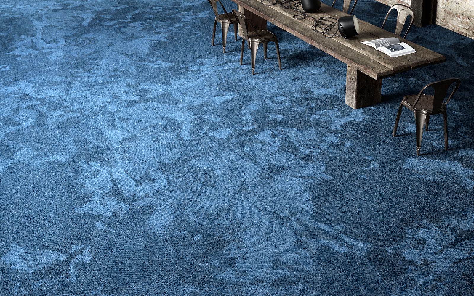 A blue wall-to-wall carpet from the Reform Terra collection by ege