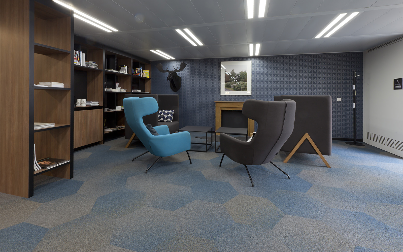 faded blue and beige hexagon carpet tiles by ege in an office setting